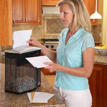 Woman Shredding Paper At Home